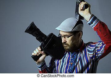 Thinking bearded man two old retro film camera