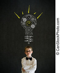 Thinking boy dressed as business man with bright idea gear...