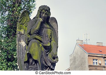 Thinking broody angel statue on Malostransky cemetery,...
