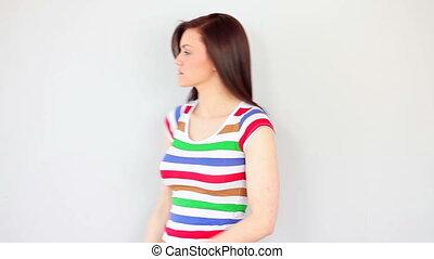 Thinking brunette posing