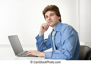 thinking business man with laptop