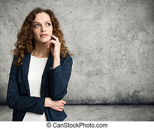 Thinking business woman looking up