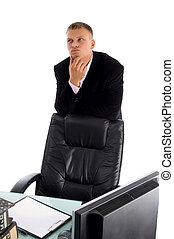 thinking businessman in an office