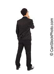 Thinking businessman isolated on white background