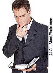thinking businessman with diary