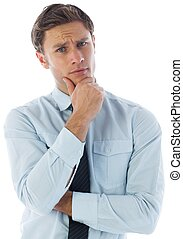 Thinking businessman with hand on chin on white background