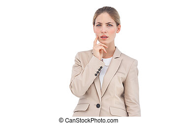 Thinking businesswoman looking at the camera