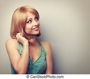 Thinking cute young blond woman looking up. Vintage portrait