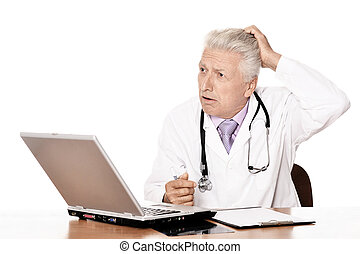 Thinking doctor with a laptop on white background