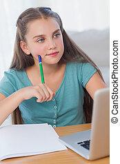 Thinking girl doing her homework