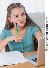 Thinking girl doing her homework