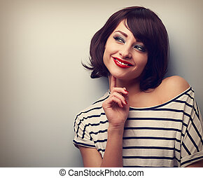 Thinking happy young modern woman looking on copy space. Closeup