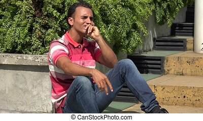 Thinking Hispanic Male Sitting