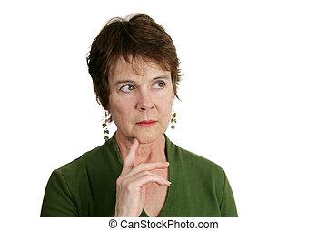 Thinking It Over - A pretty, mature Irish woman lost in...
