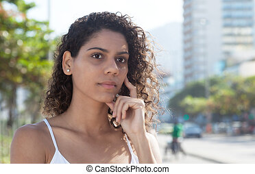 Thinking latin woman in the city - Thinking latin woman in a...