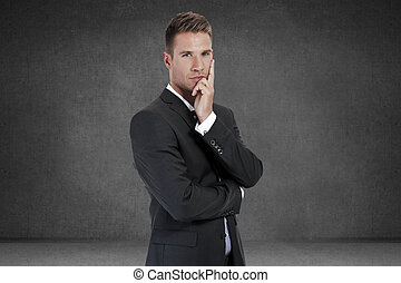 Thinking man. Closeup portrait of a casual young pensive businessman