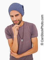 Thinking man wearing beanie hat