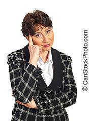 Thinking mature business woman