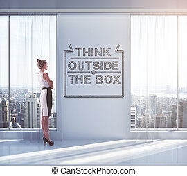 Thinking outside the box - Businesswoman looking outside of...