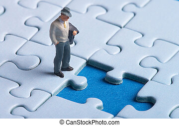 thinking - plastic figure standing in front of a hole in a...