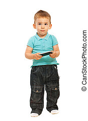 Thinking toddler holding cellphone