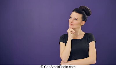 Thinking woman at lilac background