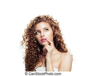 Thinking woman. Female model with healthy skin and perfect wavy hair isolated