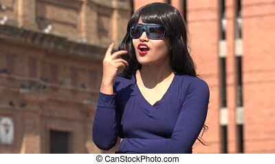 Thinking Woman Having An Idea Wearing Sunglasses And Wig