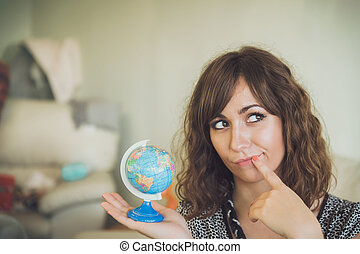 Thinking Woman Holding Small Globe in Hand