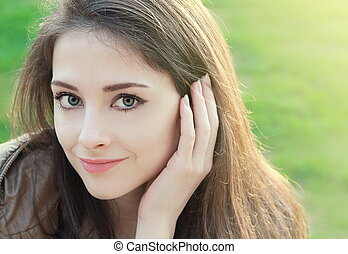Thinking woman looking calm outdoors summer sun background. ...