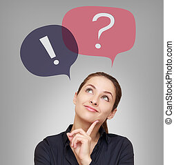 Thinking woman looking on question and exclamation above on...