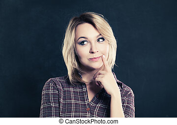 Thinking Woman on Dark Background