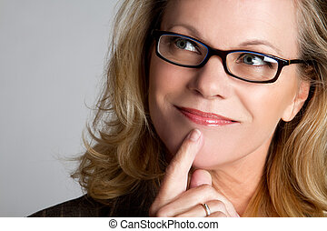 Thinking Woman - Thinking woman wearing glasses