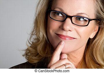 Thinking Woman - Thinking woman wearing glasses