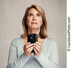 thinking woman with smartphone