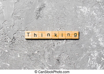 thinking word written on wood block. thinking text on cement table for your desing, concept