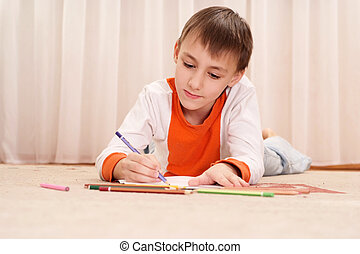 Thinking young boy  with  pencils