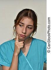 Thinking Young Female Nurse
