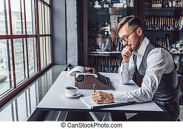 Thinking young man at work