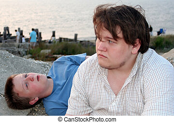 ThinkingBeachTeens 2 - Two teenage boys with thoughtful...