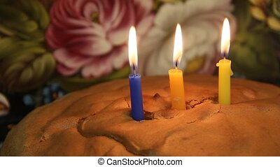 Third birthday cake and candles