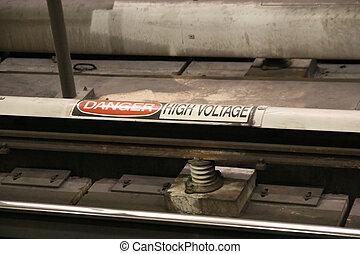 Third Rail - A high voltage warning sign on the third rail ...
