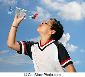 Thirsty boy drinking water outdoors