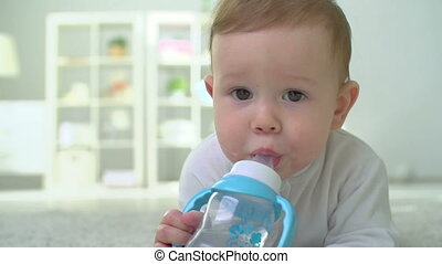 Thirsty Child - Infant lying on the floor and looking...