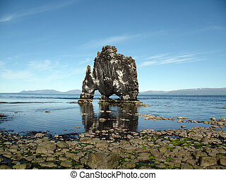 Hvitserkur: A very thirsty dragon, or is it a troll turned to stone?