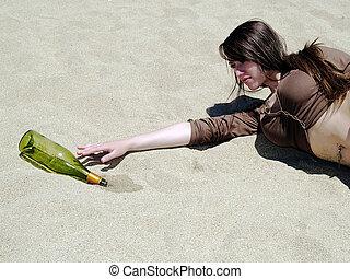 Thirsty girl reaching at desert - Girl lying on the sand...