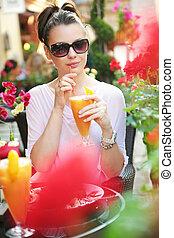 Thirsty lady drinking an orange juice
