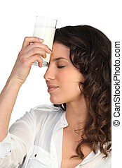 Thirsty woman drinking milk