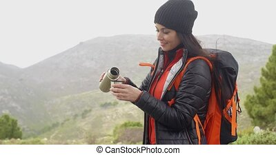 Thirsty young woman backpacker - Thirsty attractive young...