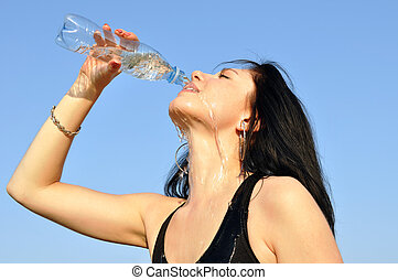 thirsty young woman drinking cold water